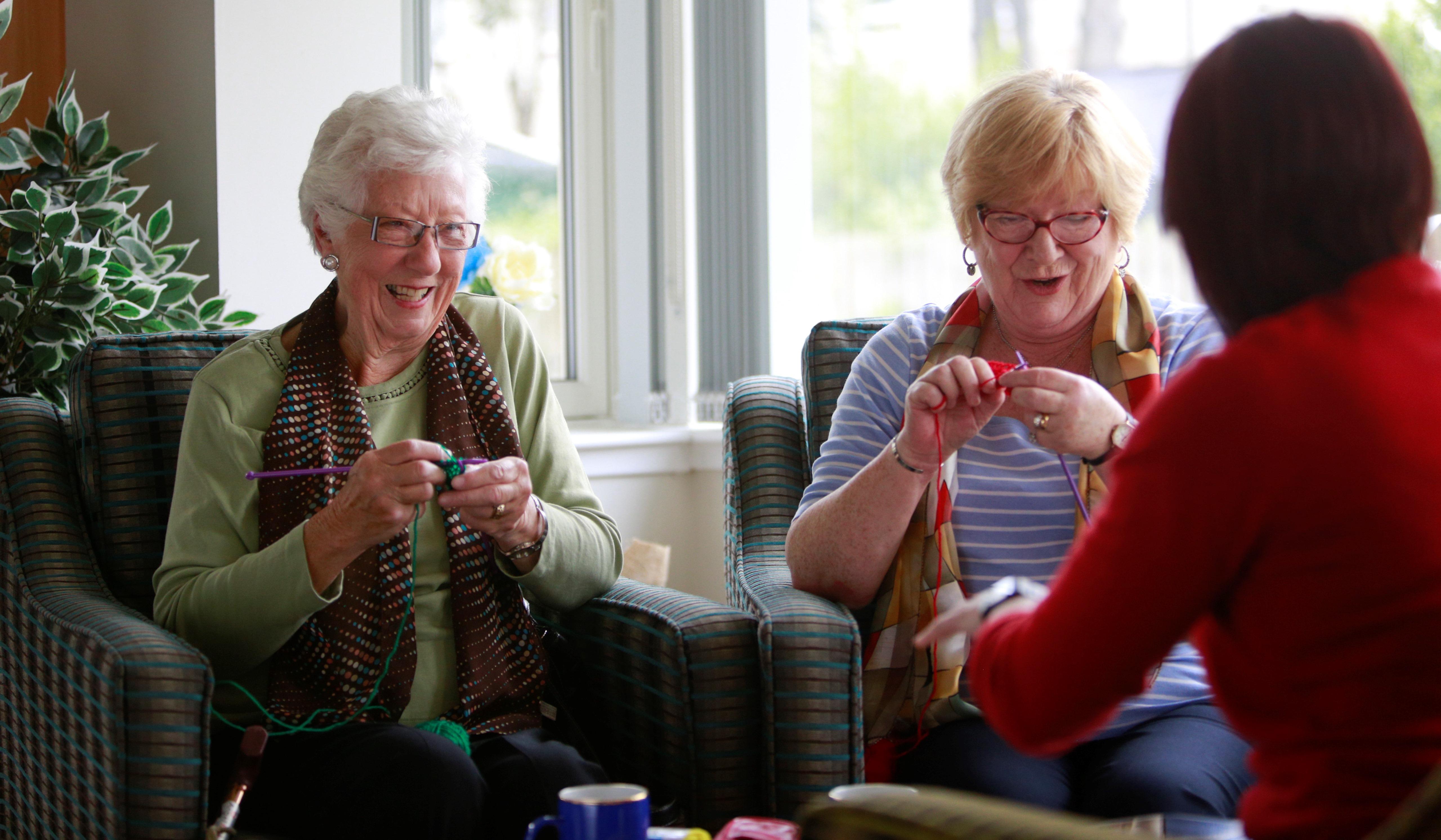 Two customers enjoying their knitting class