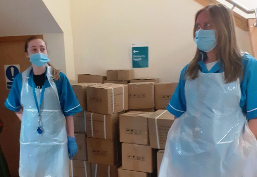 Wheatley Care staff stand next to supplies